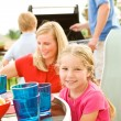Summer: Family Having Dinner on Deck — Stock Photo #26309897
