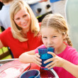 Summer: Girl Drinking Lemonade at Table — Stock Photo #26309979