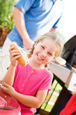Summer: Girl Hungry for Hot Dog Dinner — Stock Photo