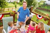Summer: Dad Serves Up Hamburgers and Hot Dogs — Stock Photo