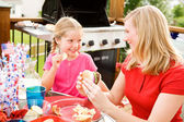 Summer: Girl Stealing Chip from Mother — Stock Photo