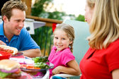 Summer: Little Girl During Family Dinner — Stock Photo