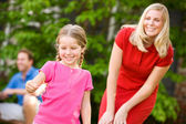 Summer: Mom Supervises Daughter with Sparkler — Stock Photo