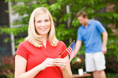 Summer: Woman with American Flag — Stock Photo