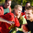 Football: Guy Runs with Ball Around Defense — Stock Photo #26784941