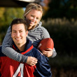 Football: Girlfriend Rides Piggyback — Stock Photo