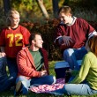 Stock Photo: Football: Group of Friends Having Picnic in Park