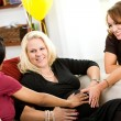 Baby Shower: Friends Feeling the Baby Moving — Stock Photo #27514815