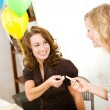 Stock Photo: Baby Shower: Woman Gives Up Clothespin to Friend