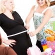 Stock Photo: Baby Shower: Measuring Size of Mom's Tummy