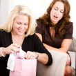 Baby Shower: Mom Opens Shower Gifts — Stock Photo #27515237