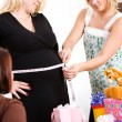 Foto de Stock  : Baby Shower: Guessing Size of Mother's Belly