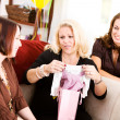 Stock Photo: Baby Shower: Mom Opens Shower Gifts