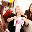Baby Shower: Mom Opens Shower Gifts — Stock Photo #27515291