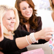 Baby Shower: Mom Opens Shower Gifts — Stock Photo #27515299