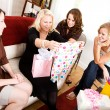 Stock Photo: Baby Shower: Mom Gets Baby Clothing Gift