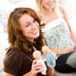 Baby Shower: Woman Holds Twin Baby Dolls — Stock Photo #27515455
