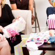 Baby Shower: Woman Unwrapping Gift — Stock Photo