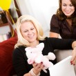 Baby Shower: Woman Gets Stuffed Animal as Gift — Stock Photo