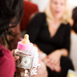 Baby Shower: Woman Gives Gift of Bank with Money — Stock Photo