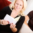 Baby Shower: Mother Reads Greeting Card — Stock Photo #27515605