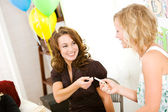 Baby Shower: Woman Gives Up Clothespin to Friend — Stock Photo