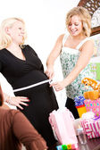 Baby Shower: Measuring the Size of Mom's Tummy — Stock Photo