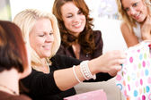 Baby Shower: Mom Opens Shower Gifts — Stock Photo