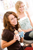 Baby Shower: Woman Holds Twin Baby Dolls — Stock Photo