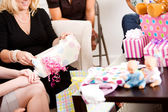 Baby Shower: Woman Unwrapping Gift — Stok fotoğraf