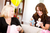 Baby Shower: Guest Playing with Baby Dolls — Stock Photo