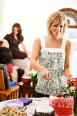 Baby Shower: Party Guest Gets Punch — Stock Photo