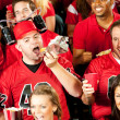 Stock Photo: Fans: Male FEats Hot Dog With Beer Helmet On