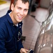 Mechanic: At Work Checking Tire Pressure — Stock Photo