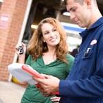 Mechanic: Woman Ready to Take Vehicle — Stock Photo