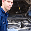 Stock Photo: Mechanic: Trustworthy Mechanic By SUV