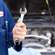 Mechanic: Holding a Wrench — Stock Photo