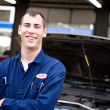 Stock Photo: Mechanic: Cheerful Mechanic at Repair Shop