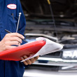 Mechanic: Writing On Clipboard — Stock Photo