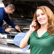 Mechanic: Woman Calling for Ride from Auto Shop — Stock Photo #30627723