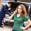 Mechanic: Woman Angry At Repair Cost — Stock Photo