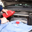 Mechanic: Pouring Oil Into Engine — Foto Stock