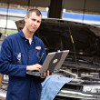 Mechanic: Checking Diagnostics on Laptop — Stock Photo #30627885