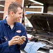 Mechanic: Worker Makes Money from Overcharging — Stock Photo #30627895