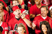 Fans: Male Fan Eats Hot Dog With Beer Helmet On — Stock Photo