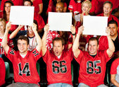 Fans: Guys Holding Up Small Blank Signs — Stock Photo