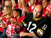 Fans: Visiting Team Fan Upset By Losing Plays — Stock Photo