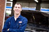 Mechanic: Cheerful Mechanic at Repair Shop — Stock Photo