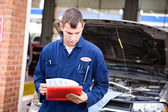 Mechanic: Reading Diagnostic Report — Stock Photo