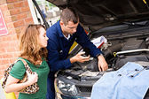 Mechanic: Man Explains Charge for Repairs — Stock Photo